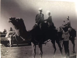 Margaret Emery and Joyce Cowie ride a camel in Eulo.