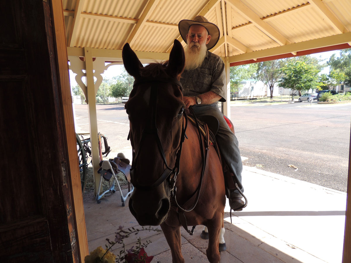 Les Capewell riding horse into Club Boutique Hotel Cunnamulla