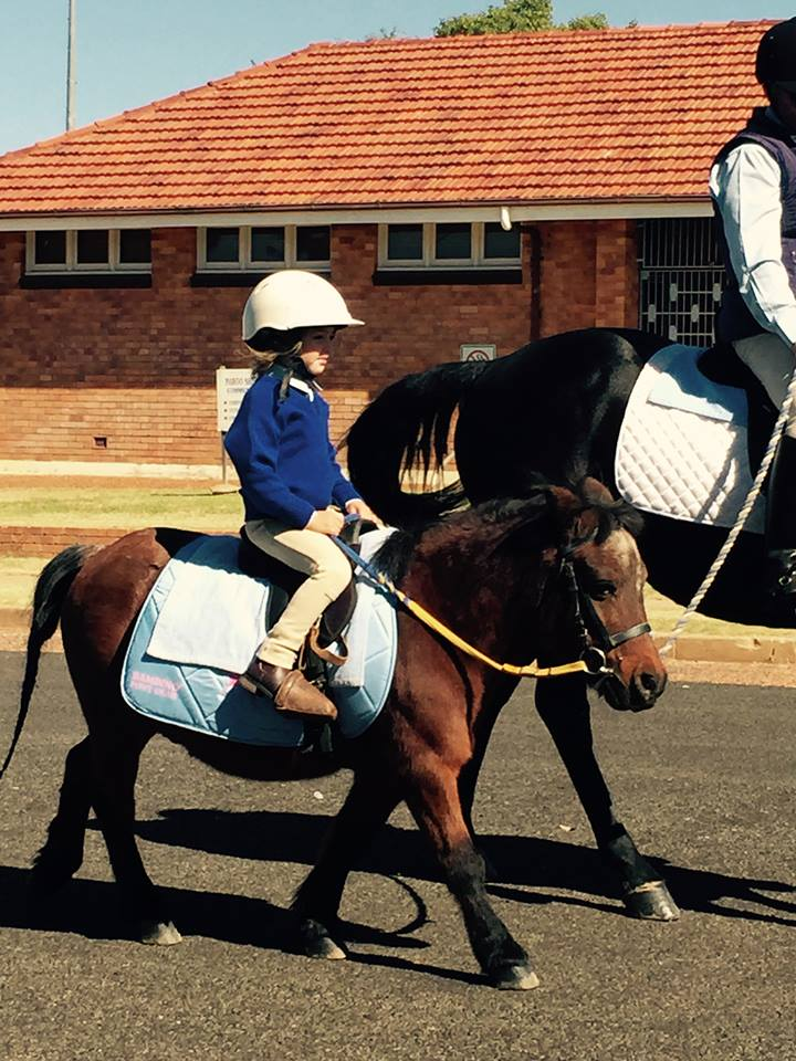 Cunnamulla Pony Club riding in the Cunnamulla Anzac Day Parade